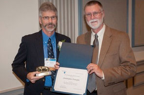 Residex CEO Chris Donaghy, left, is congratulated by Dr. Bruce McPheron, Penn State's Dean of the College of Agricultural Sciences, on his Outstanding Alumnus honor.