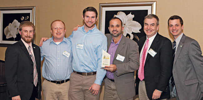 From left, LandOpt Director of Success David Gallagher; Eichenlaub sales professionals Ryan Johnson, Anthony Smith and Kevin Prall; Dan Eichenlaub; and LandOpt Success Coach Steven Bach accept their Contractor of the Year award in 2012.