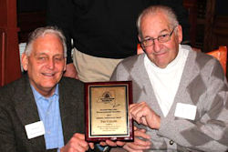 President Jeff Hathorn, left, presents a lifetime achievement award to Ted Collins.