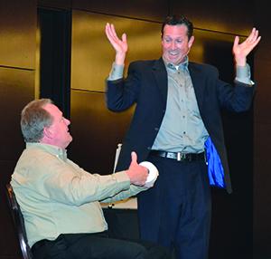 Headshot: Speaker and magician Jon Petz had some fun with John Deere's Segment Marketing Manager Ken Taylor.