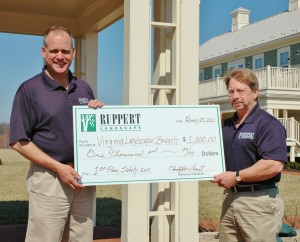 The safety incentive program rewards company field managers and branches that demonstrate their commitment to safety. Ken Thompson (left), Ruppert's Virginia Landscape Construction branch manager, accepts a check and award on his team's behalf from Dave Sanders, Ruppert's safety and loss prevention manager, for being the company's safest branch of the year. Photo: Ruppert Landscape.