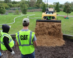 As part of PLANET Gives Back, a playground at Home of the Innocents gets new mulch. Photo: Sarah Pfledderer.