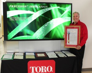 On behalf of Toro, Robert Starr, of the company's water management group, is recognized for promoting 'Smart Irrigation Month.' Photo: Toro.