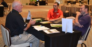 Attendees have a one-on-one supplier meeting with Quali-Pro. Photo: Landscape Management.