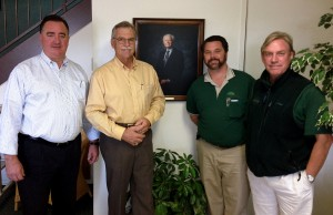 (From left) Peter Andreucci, manager of Bartlett's California offices; Randy Finch, former owner of Finch Tree; a portrait of  Fred Finch, founder of Finch Tree; Daniel Goyette, former president of Finch Tree; Dan Thacker, Finch Tree operations manager and arborist representative. Photo: Bartlett.