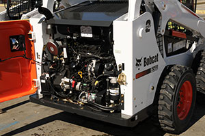 Many engine components in the new Bobcat Tier 4 loaders are easily serviced by opening the tailgate.