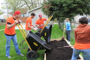 Case workers participate in the Victory Garden Blitz in Milwaukee.