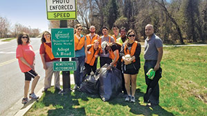 Employees at Nemetschek Vectorworks organize an outing each quarter to clean up their designated road for the Adopt- A-Road project.