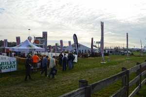 Attendees pace the aisles of the outdoor demo area, where more than 70 companies exhibited.