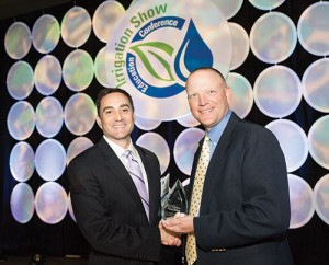 Michael Dukes (right) receives the Irrigation Assocation Excellence in Education Award at the 2014 Irrigation Show & Education Conference from J.R. Bergantino. Photo: Irrigation Association