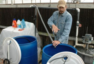 """Raul Cabrera demonstrates some intricacies of his research project, """"Use of Alternative Irrigation Water Sources for Urban Landscapes and Nursery Crops."""" Photo: NENA"""