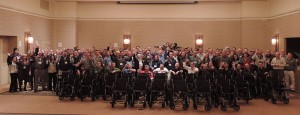 At its annual sales conference, SavATree arborists built and donated wheelchairs to 30 senior citizens. Photo: SavATree