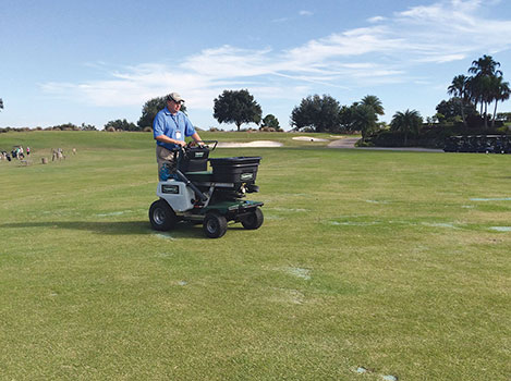 Jason Collins, regional sales manager for Turfco, demonstrates its spreader/sprayer at the 2014 LM Lawn Care Forum in Orlando, Fla. Photo: LM
