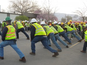 Heads Up employees stretch together as part of the company's 2015 Equipment Rodeo. Photo: Heads Up