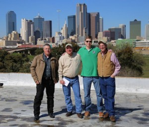 From left: A.J. Thibodeaux, CEO of Preservation Tree Service; Mark Childress, maintenance services division manager of Texas Land Care; Wayne Walker, executive director of OurCalling; Dugan Smith, COO of Texas Land Care.