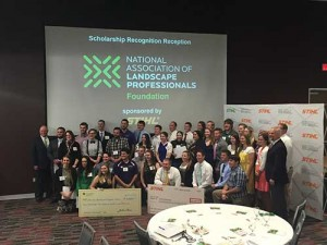 Rodger Phelps of Stihl poses for a picture with the 53 Foundation Scholarship recipients. Stihl sponsored the event.