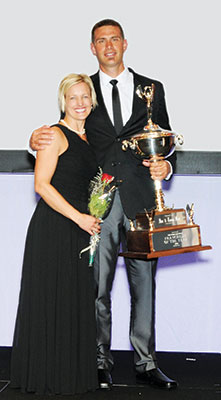 Dan Reid with his wife, Janna, accepting a Franchisee of the Year Award.