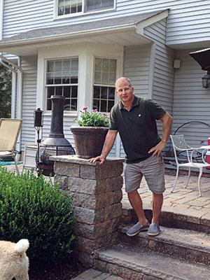 Chris Demato, owner of Rock Bottom Landscaping & Fencing.