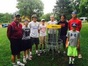 Belle Plaine, MN volunteers and local children gather to transform Court Square Park into a disk golf course for the entire community to enjoy.