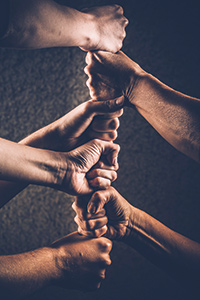 iS78951315stacked-hands Photo: ©istock.com/Redrockschool