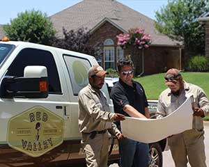 Mike Freeman (center), founded Red Valley Landscape & Construction in 2012.