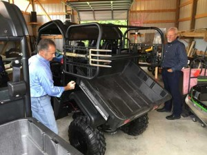 Bello demonstrates how the CrewMaster attachment still affords full use of the UTV's bed.