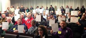 Opponents of Bill 52-14 attend a Montgomery County, Md., council meeting discussing a proposed cosmetic pesticide ban. The bill passed in October.