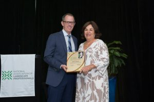 Abby Santos receives NALP's Woman Entrepreneur of the Year Award from Scott Jamieson.