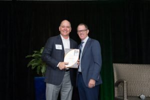Jim McCutcheon receives the NALP Lifetime Leadership Award from Scott Jamieson.