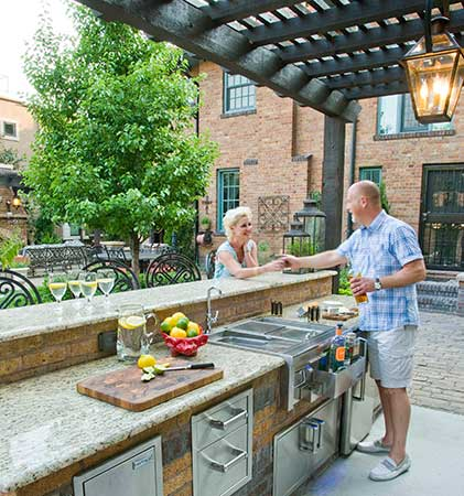Owners in outdoor kitchen