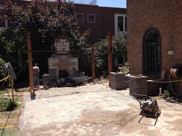 Construction of fireplace, pergola and dining patio