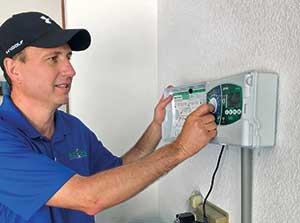 Man checking irrigation system