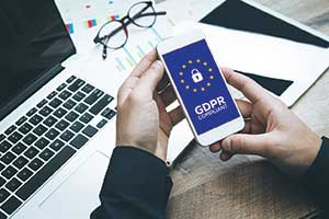 hands holding phone GDPR. Photo illustration: iStock.com/cnythzl