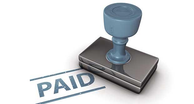 Paid stamp; Image: iStock.com/jimmyjamesbond