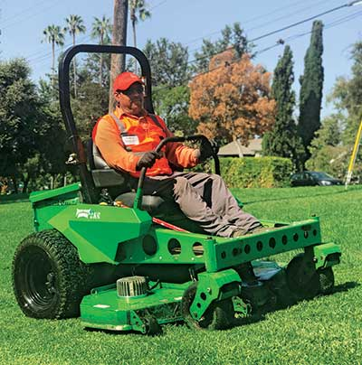 Man on a mower (Photo: LandCare Pasadena)