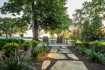 Riverfront mansion. Contractor: GoldGlo Landscapes (Photo: ICPI)