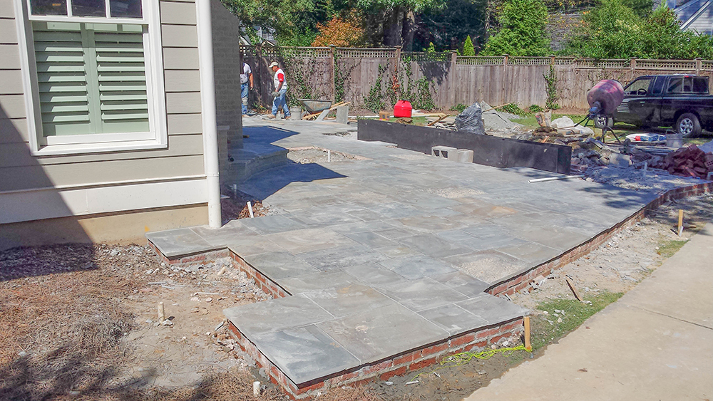 Installation of bluestone patio (Photo: Dry Branch Photography)