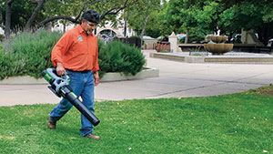 Man with battery-powered blower (Photo: American Green Zone Alliance)