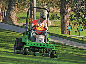 Man on battery-powered mower (Photo: American Green Zone Alliance)
