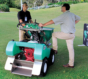 <strong>Made in the shade</strong> Rob Edwards, VP of operations for Turfware, discusses the TR360 ride-on spreader-sprayer. (Photo: Seth Jones)