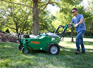 Man aerating (Photo: Billy Goat Industries)