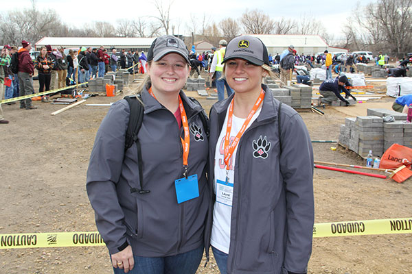 North Carolina State University students Taylor Adams and Laurel York were cheering on their fellow NCSU students at the Hardscape Installation event. (Photo: Seth Jones)