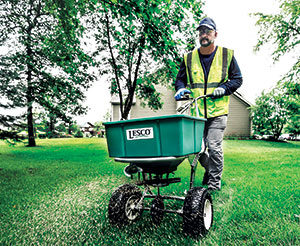 Crew member operating a spreader (Photo: SiteOne Landscape Supply)