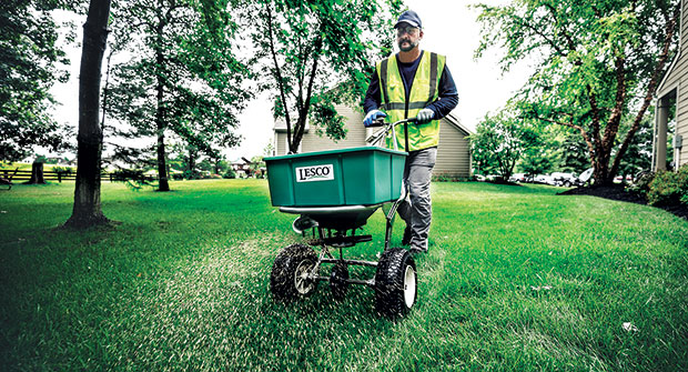 Crew member operating spreader (Photo: SiteOne Landscape Supply)