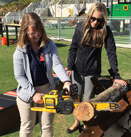 Sarah Webb demoing chainsaw (Photo: LM Staff)