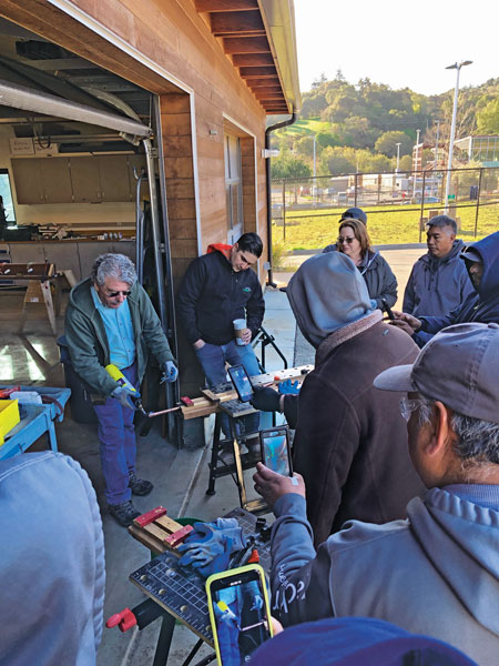 Gachina Landscape Management team members watch a demonstration by Frank Niccoli at Foothill College's John Paul and H. Jaclyn Ishimaru-Gachina Learning Center. Photo: Chad Sutton, Gachina Landscape Management
