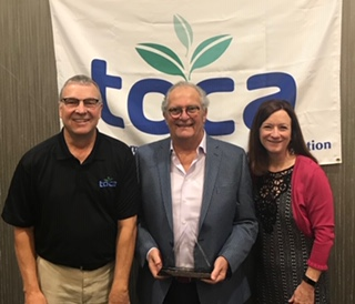 TOCA Executive Director Den Gardner (left) and Project EverGreen Executive Director Cindy Code (right) present Norman Goldenberg with the 2019 Environmental Communicator Award. PHOTO: PROJECT EVERGREEN