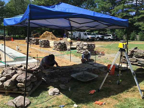 Install crews under tent (Photo: Ledden Palimeno Landscape Co.)