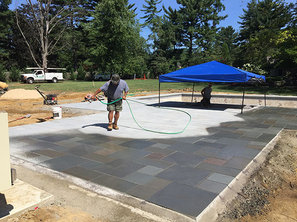 Spraying pavers (Photo: Ledden Palimeno Landscape Co.)