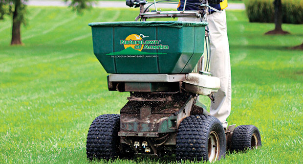 Man performing lawn care services (Photo: Naturalawn of America)